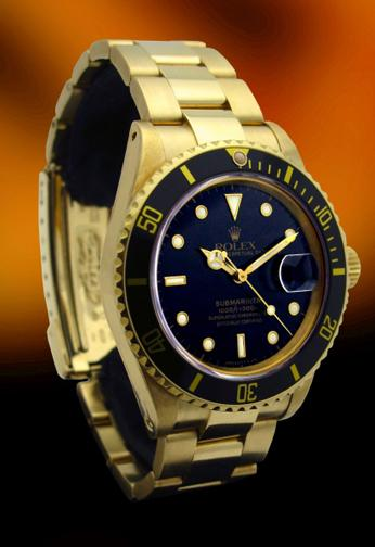 Rolex 16808 Yellow gold Submariner with original black dial